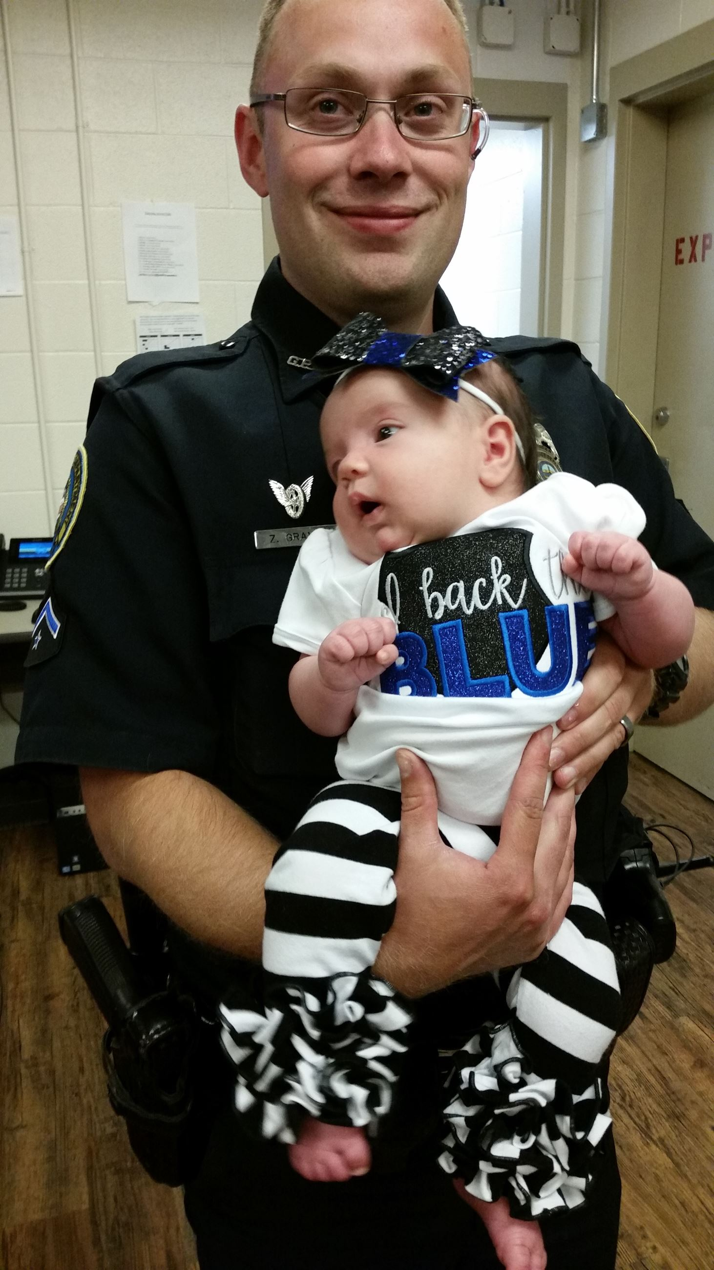 Officer holding baby