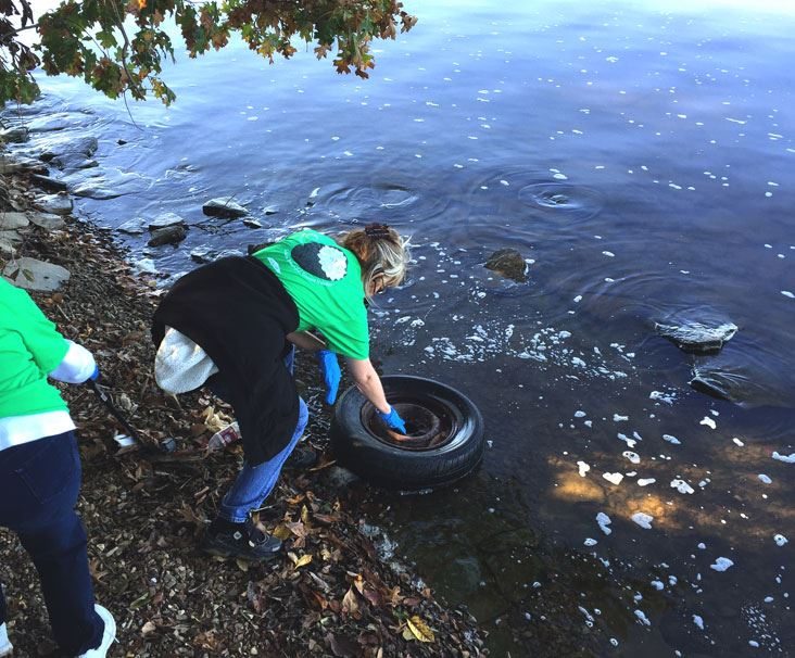 Volunteers Pull Tire from Old Hickory Lake