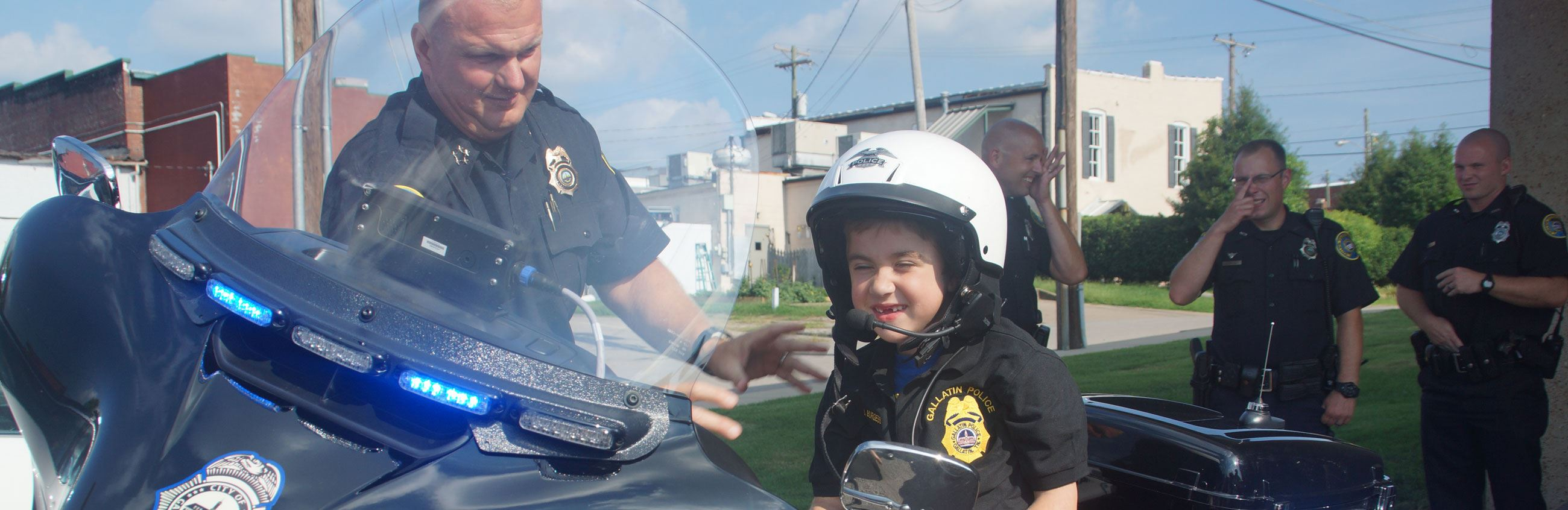 Chief Bandy with kid on Motorcycle