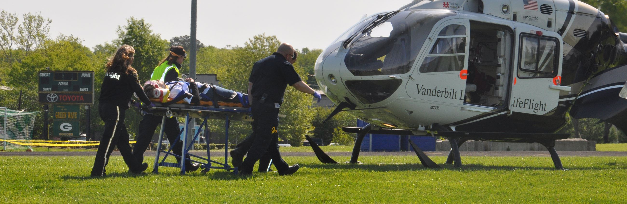 Emergency Crew Loads Victim on Helicopter