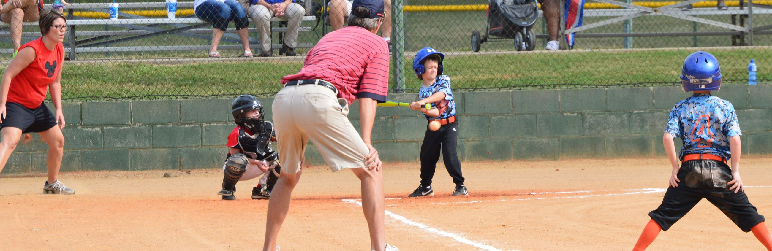 Kid at Bat at Baseball Game