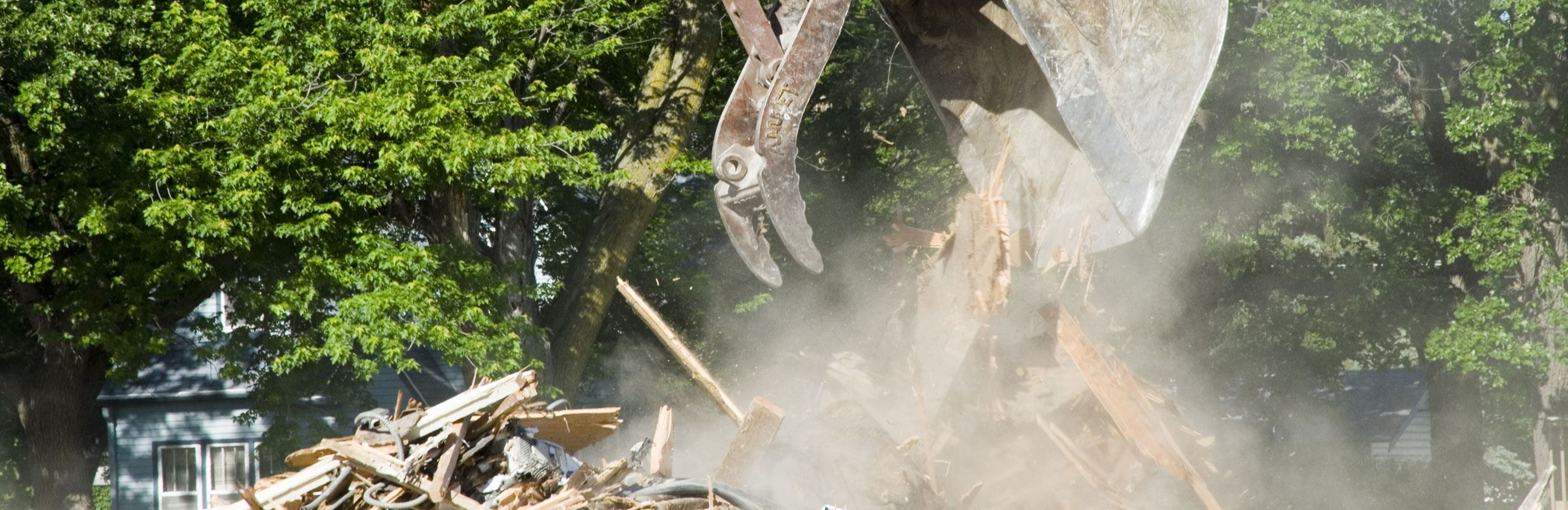 Backhoe Conducting Demolition