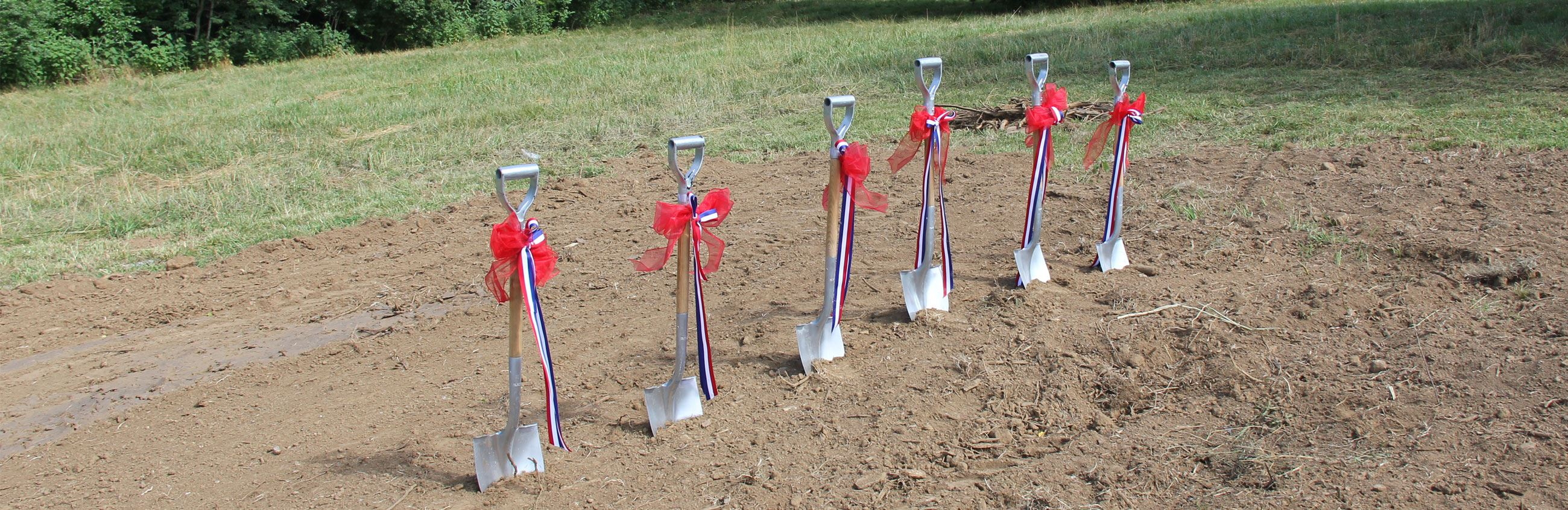 Groundbreaking shovels stuck in the dirt