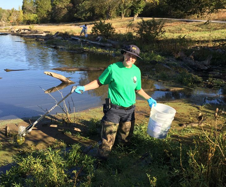 Cleanup Volunteer in waders in Old Hickory Lake