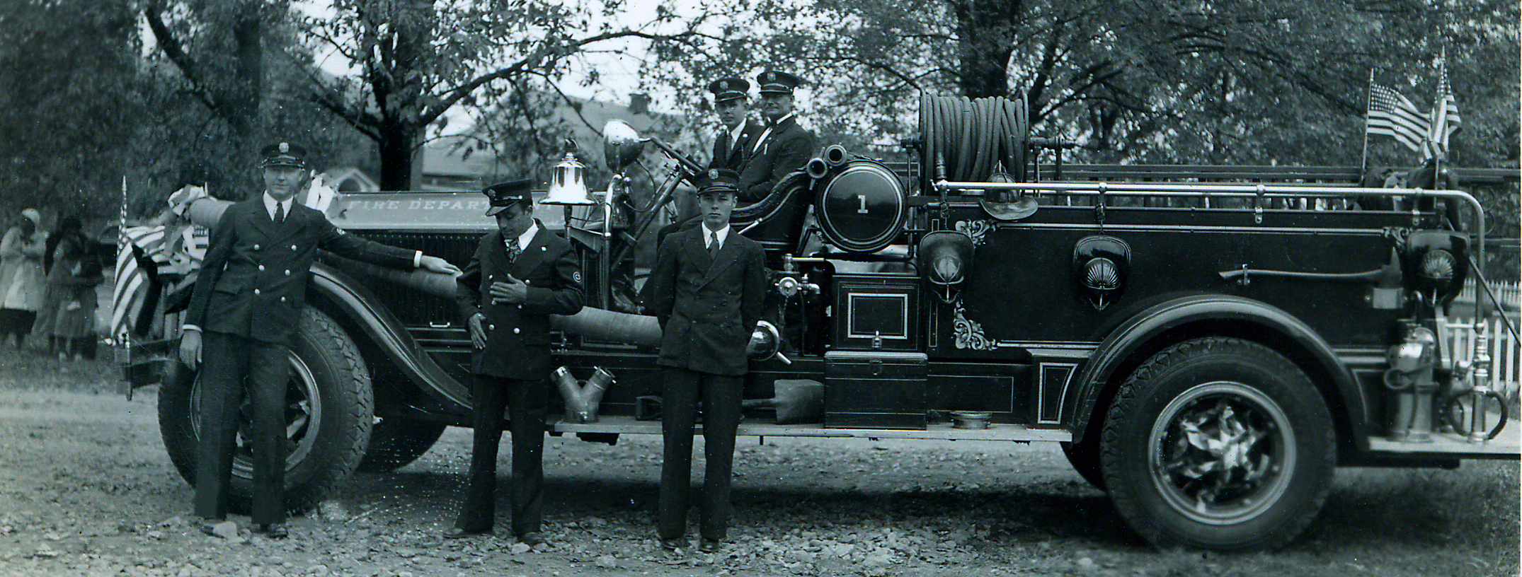 Historic photo of Fire Engine Number one with fire fighters standing in front