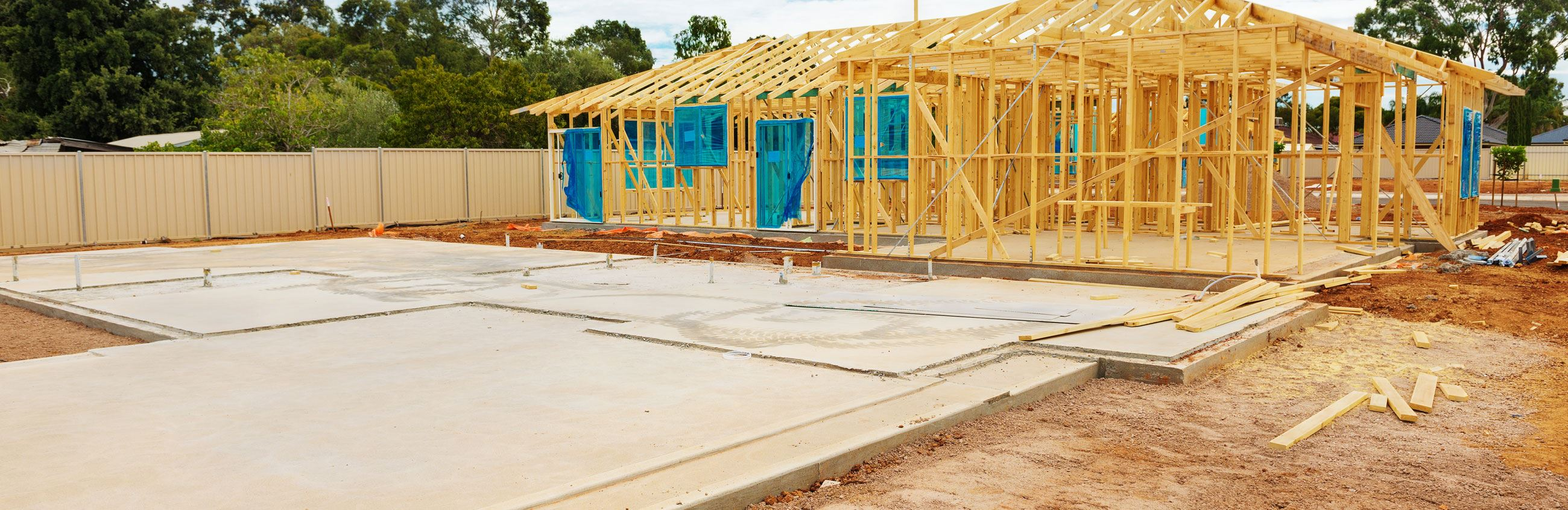 Framed house and driveway under construction