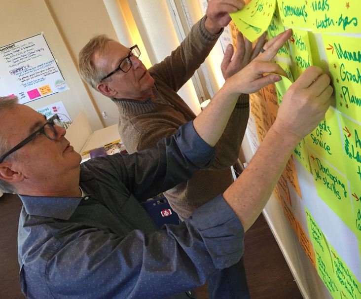 City employees brainstorm using sticky notes on wall