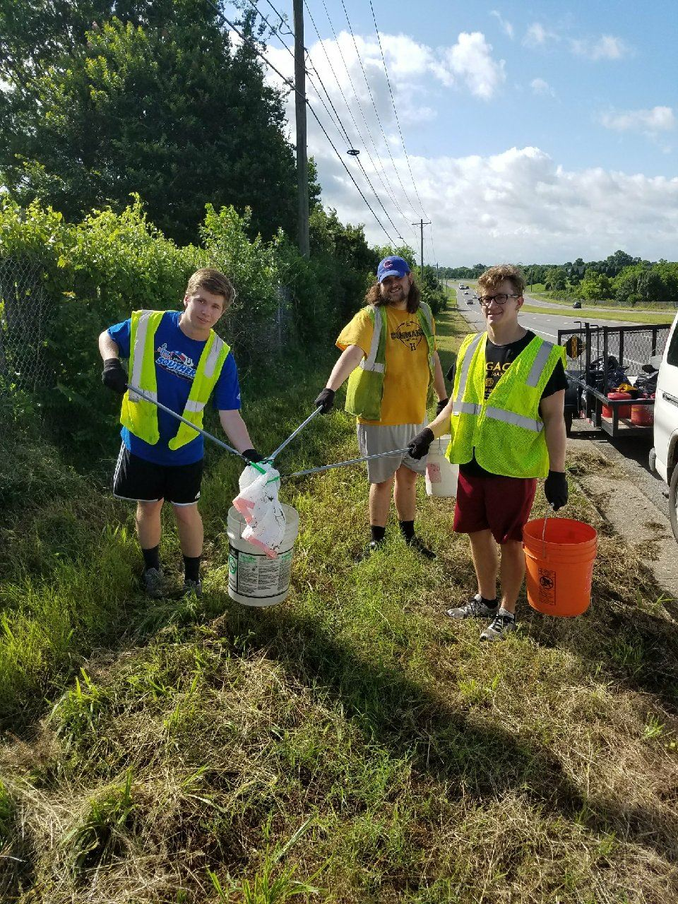 Student Volunteers in Safety Vests on Litter Detail