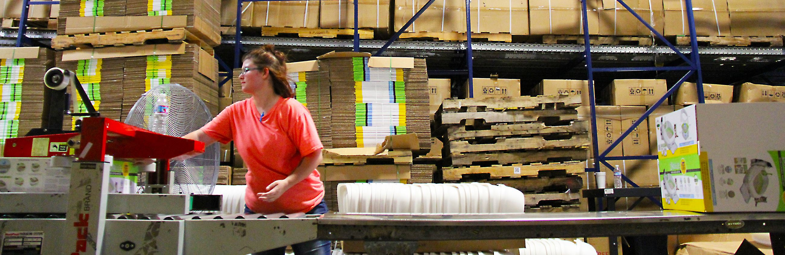 Young woman working in a warehouse