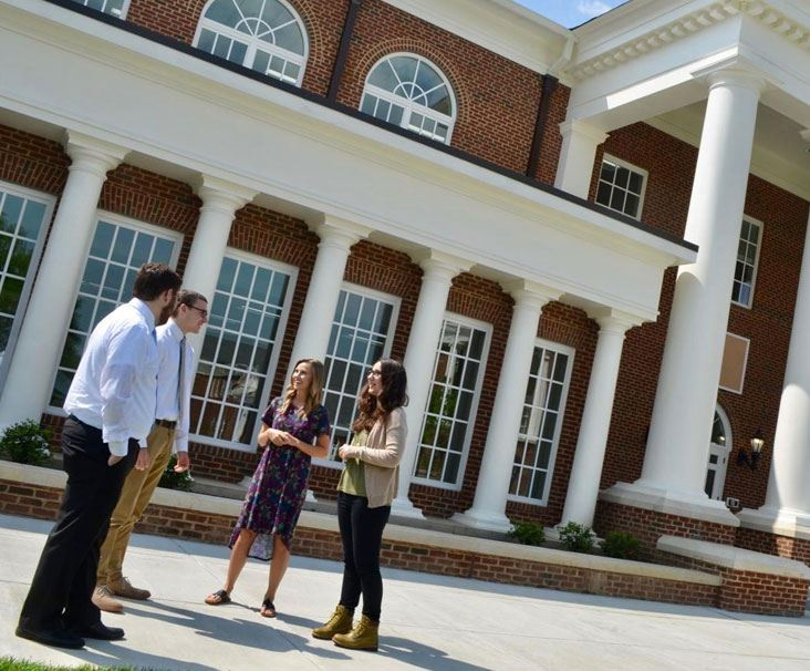 Welch College students in front of campus building in Gallatin