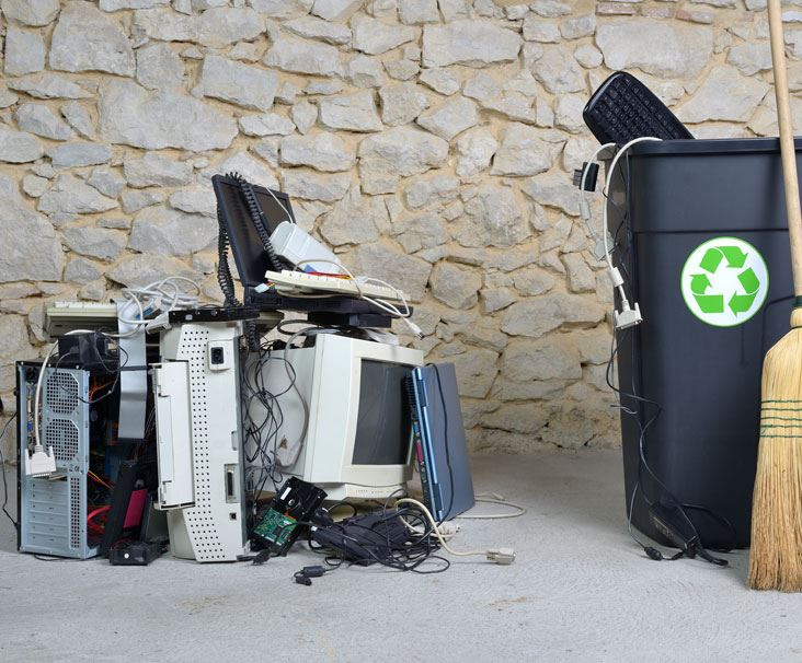 Electronics next to recycling bins