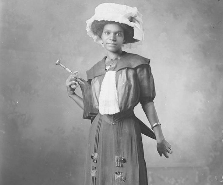 Old photo of woman in fancy hat and umbrella from the Stark Collection