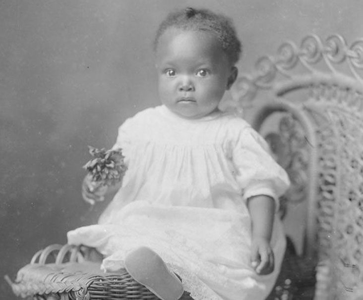 Old picture of Sumner County baby on wicker chair