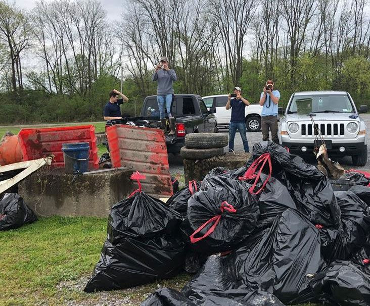 Volunteers pick up trash along Big Station Camp Creek Road