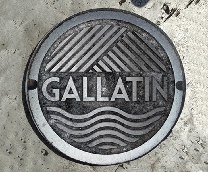 Manhole cover with Gallatin imprint