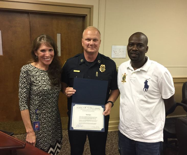 GPD Chief presents accommodation to Randy Rogers for heroism