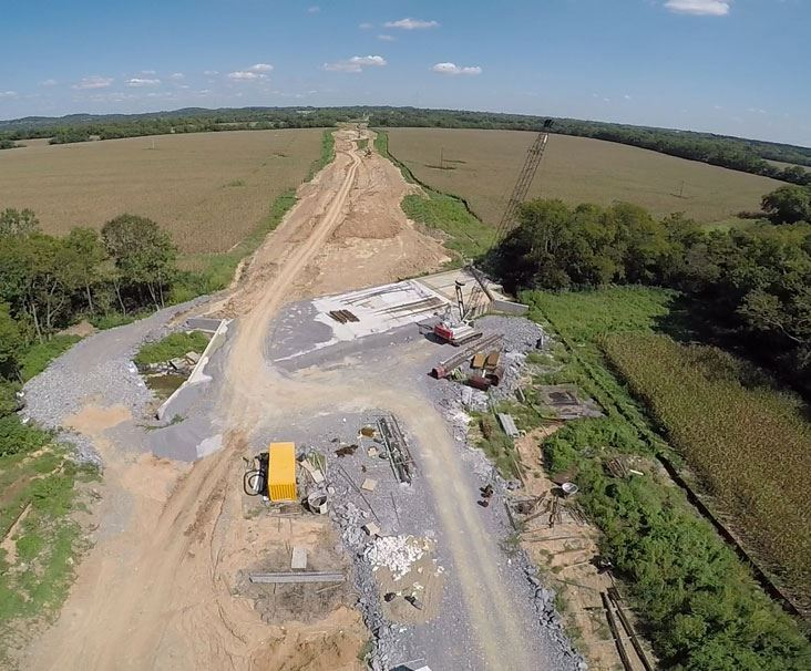 Aerial shot of crane and road construction on Albert Gallatin Road