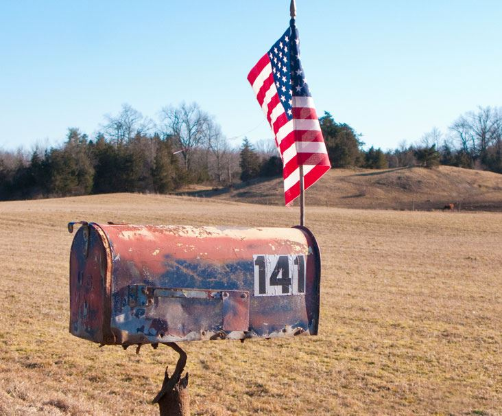 Mailbox with American Flag stuck on top