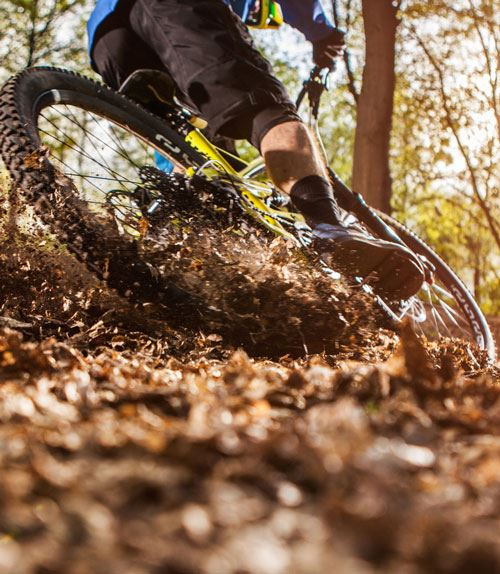 Mountainbike power-sliding through leaves at Lock 4 Park