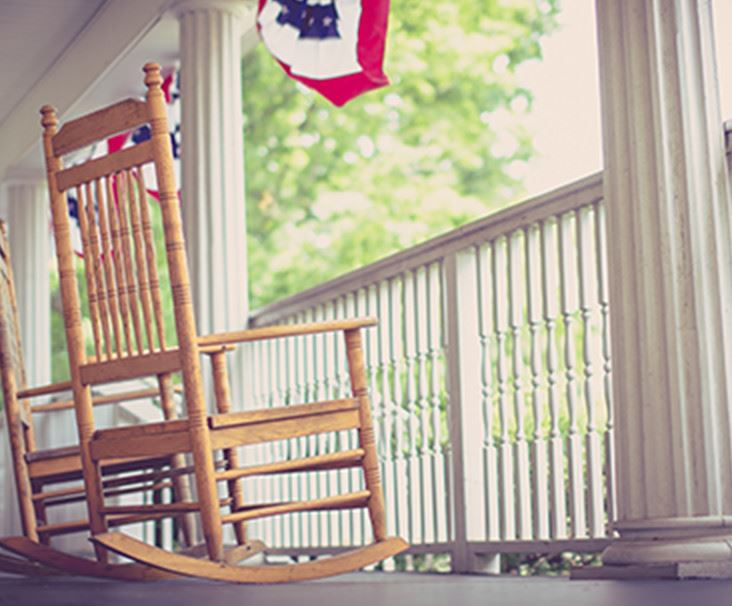 Rocking Chair on White Porch
