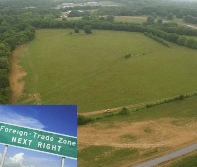 Aerial view of open field, text on sign Foreign Trade Zone