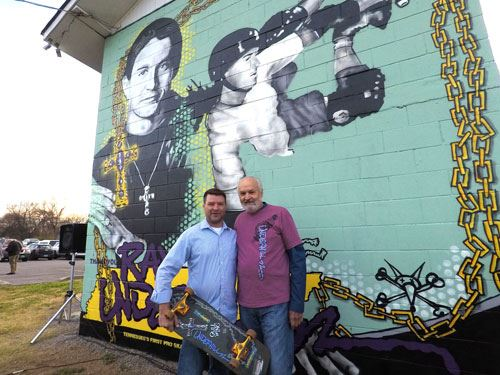 Mural artist Bryan Deese with Ray Underhill's father